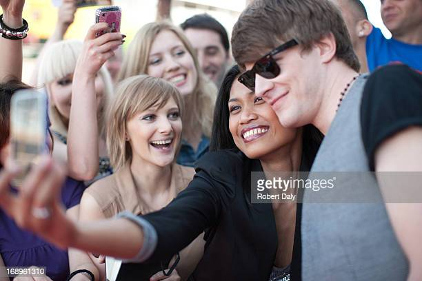 fan taking picture of herself with celebrity - celebrities photos stock pictures, royalty-free photos & images