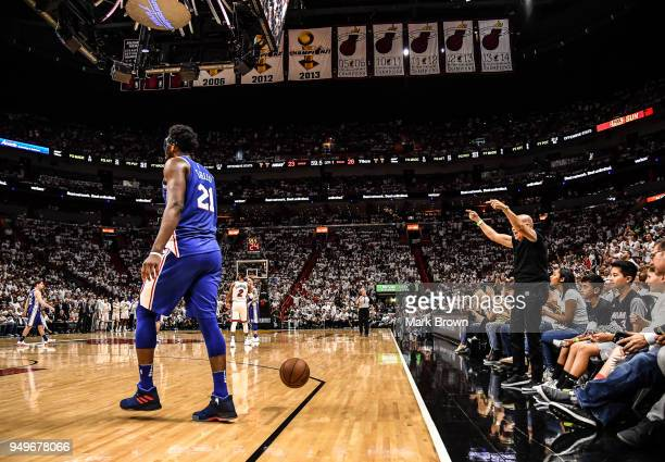 A fan taunts Joel Embiid of the Philadelphia 76ers in the first quarter during the game against the Miami Heat at Game Four of Round One of the 2018...