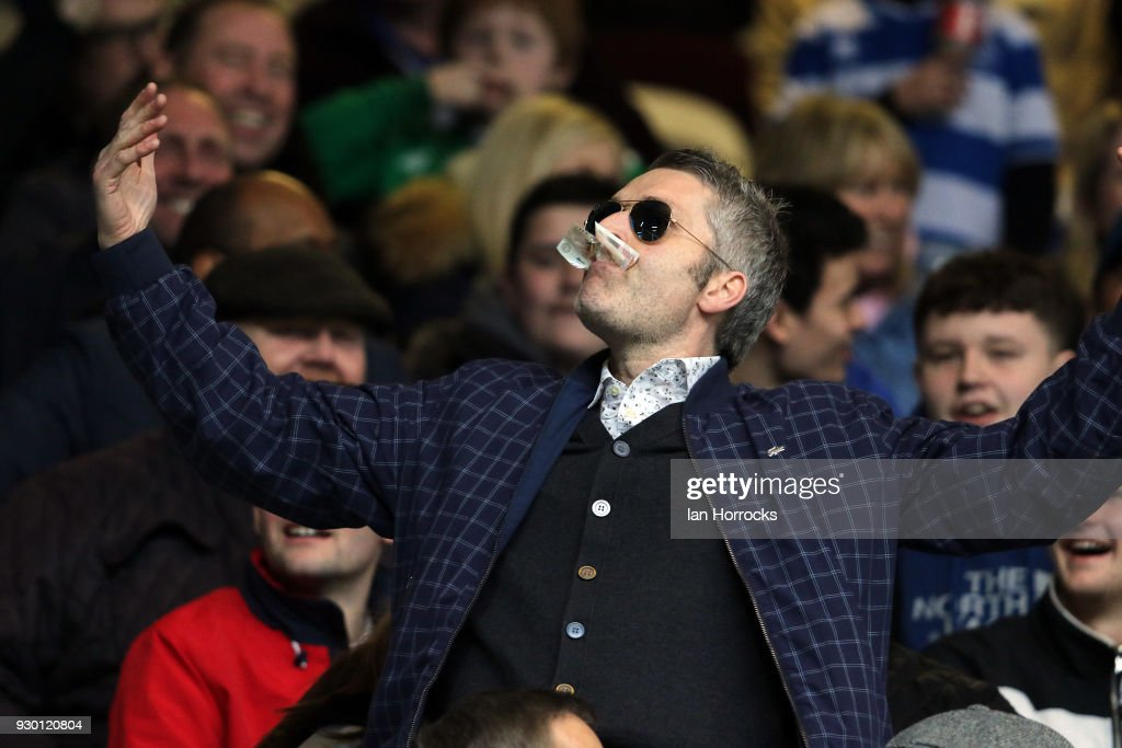 A QPR fan taunts the Sunderland fans by eating a ten pound note during the Sky Bet Championship match between Queens Park Rangers and Sunderland at Loftus Road on March 10, 2018 in London, England.