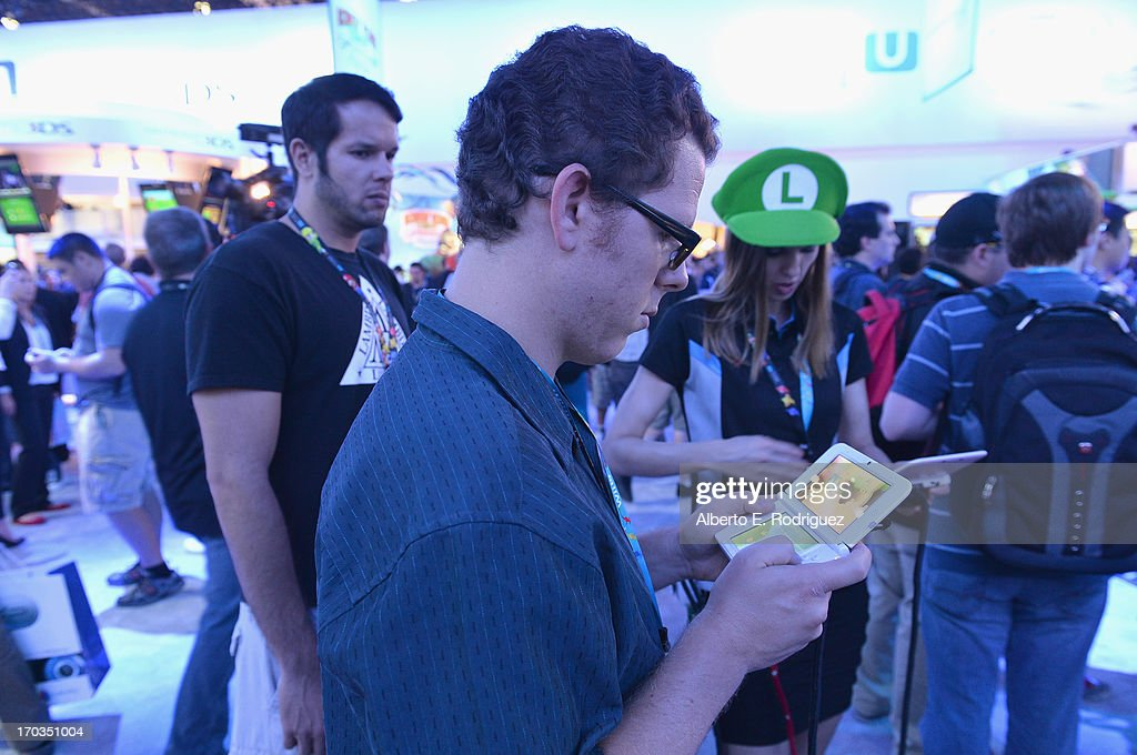 A fan tries out a Nintendo DS at the E3 Gaming and Technology Conference at the Los Angeles Convention Center on June 11, 2013 in Los Angeles, California.