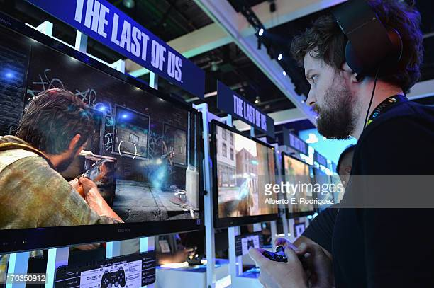 A fan tries The Last Of Us Sony Playstation 4 game at the E3 Gaming and Technology Conference at the Los Angeles Convention Center on June 11 2013 in...
