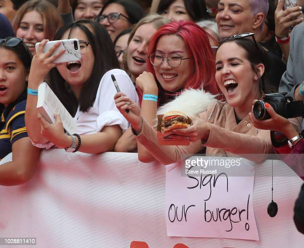 TORONTO ON SEPTEMBER 7 A fan tries to get her burger signed on the red carpet for the World Premiere of the movie BEAUTIFUL BOY at the Toronto...