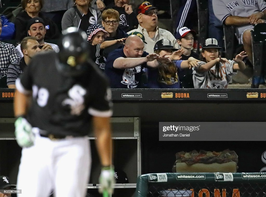 Fan try to jinx the pitchers as Jose Abreu #79 of the Chicago White Sox comes up to bat in the 9th inning against the New York Yankees at Guaranteed Rate Field on June 27, 2017 in Chicago, Illinois. The White Sox defeated the Yankees 4-3.