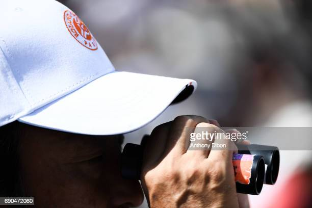 A fan use binoculars during the day 4 of the French Open at Roland Garros on May 31 2017 in Paris France