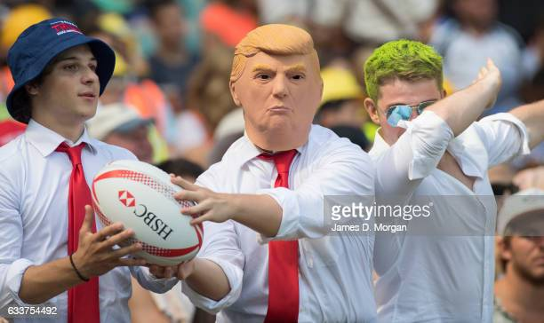 'SYDNEY AUSTRALIA FEBRUARY 04 A fan uses a Donald Trump face mask to attend the 2017 HSBC Sydney Sevens at Allianz Stadium on February 4 2017 in...