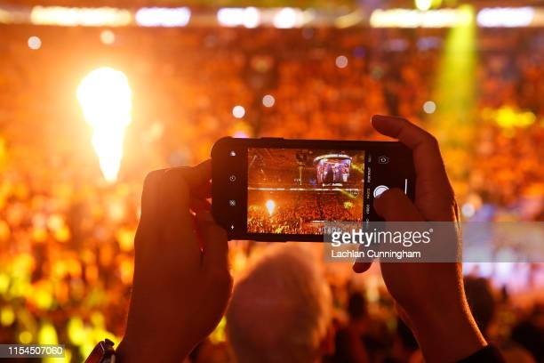 Fan uses his iPhone to take a photo of player introductions prior to Game Four of the 2019 NBA Finals between the Golden State Warriors and the...