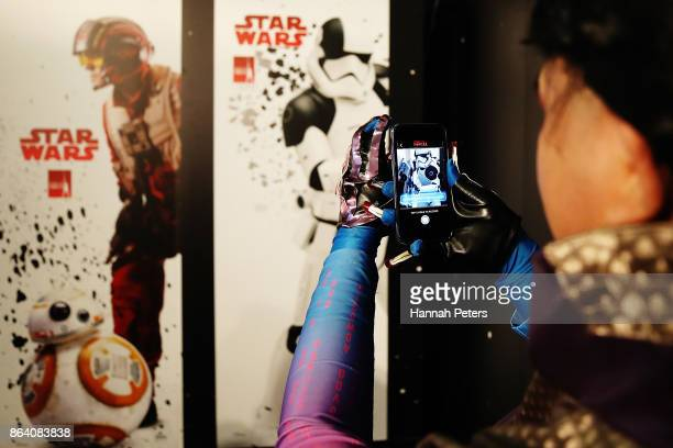A fan uses the Find The Force app at the Star Wars The Last Jedi booth at Armageddon on October 21 2017 in Auckland New Zealand