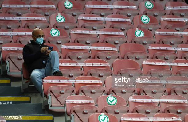 Fan wait for the start of the Serie A match between FC Internazionale and ACF Fiorentina at Stadio Giuseppe Meazza on September 26, 2020 in Milan,...