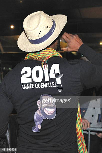 A fan waits a shirt reading 2014 the quenelle year with a drawing of the salute and an effigy of the controversial humorist Dieudonne M'bala M'bala...