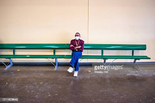 Fan waits by himself practicing social distancing during the Covid19 Pandemic in front of empty grandstands on Derby Day at Oaklawn Racing Casino...