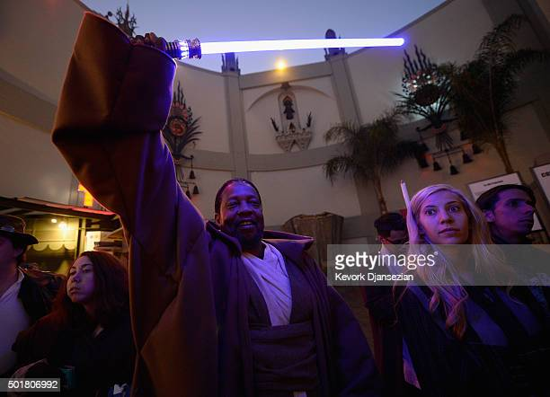 A fan waits for the opening night of Walt Disney Pictures and Lucasfilm's Star Wars The Force Awakens at TCL Chinese Theatre on December 17 2015 in...