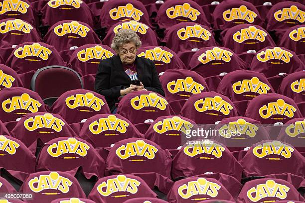 A fan waits for the start of the game between the Cleveland Cavaliers and the Miami Heat at Quicken Loans Arena on October 30 2015 in Cleveland Ohio...