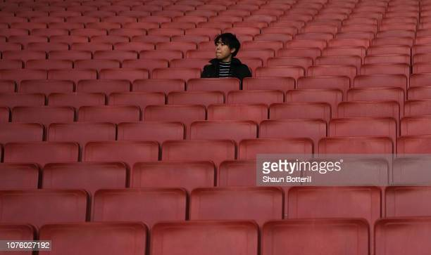 Fan waits in the seats before the Premier League match between Arsenal FC and Tottenham Hotspur at Emirates Stadium on December 02, 2018 in London,...