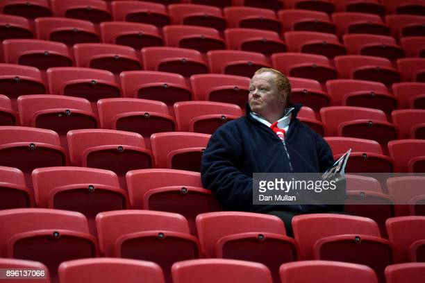 A fan waits inside the stadium prior to the Carabao Cup QuarterFinal match between Bristol City and Manchester United at Ashton Gate on December 20...