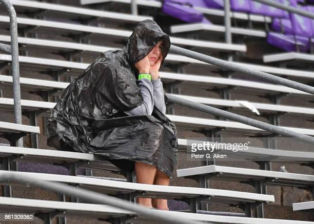 A fan waits out a weather delay at the game between the Kansas State Wildcats and the TCU Horned Frogs on October 14 2017 at Bill Snyder Family...