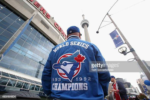 A fan waits outside the stadium before the game between the Kansas City Royals and the Toronto Blue Jays during game four of the American League...