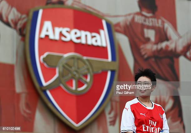 A fan waits outside the stadium prior to the Premier League match between Arsenal and Chelsea at the Emirates Stadium on September 24 2016 in London...