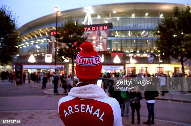 A fan waits outside the stadium prior to the Premier League match between Arsenal and West Bromwich Albion at Emirates Stadium on September 25 2017...