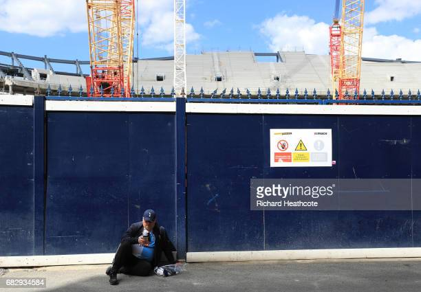A fan waits outside the stadium prior to the Premier League match between Tottenham Hotspur and Manchester United at White Hart Lane on May 14 2017...