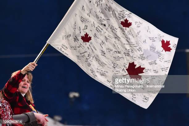 A fan waives a flag in the women's 1000m final during the ISU World Junior Short Track Championships at Maurice Richard Arena on January 27 2019 in...