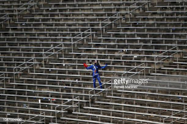 A fan walks in the stands during a game delay during the SERVPRO First Responder Bowl between the Boise State Broncos and the Boston College Eagles...