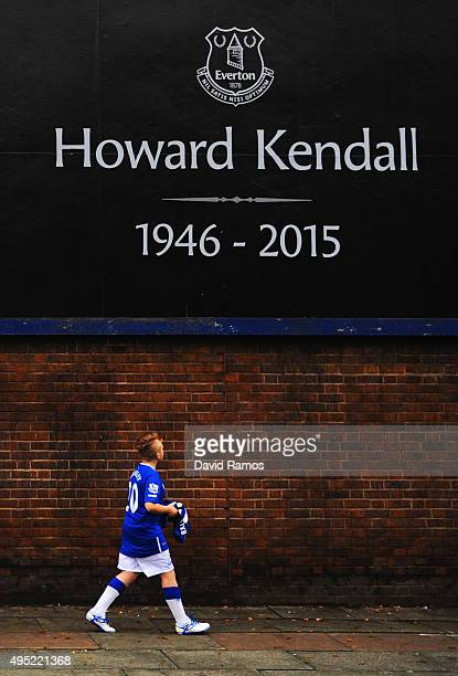 A fan walks past a tribute to former Everton player and manager Howard Kendall prior to the Barclays Premier League match between Everton and...
