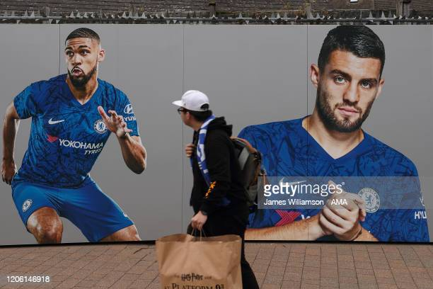 A fan walks past a wall with Ruben LoftusCheek and Mateo Kovacic on before the Premier League match between Chelsea FC and Everton FC at Stamford...