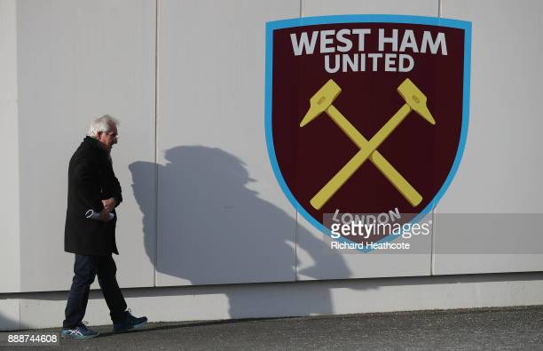 A fan walks past the West Ham crest prior to he Premier League match between West Ham United and Chelsea at London Stadium on December 9 2017 in...