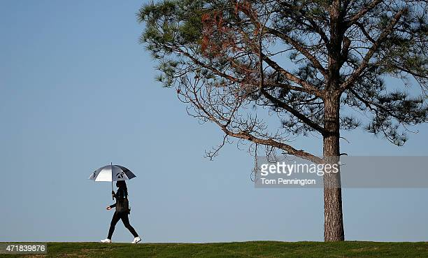 A fan walks the course during Round Two of the 2015 Volunteers of America North Texas Shootout Presented by JTBC at Las Colinas Country Club on May 1...