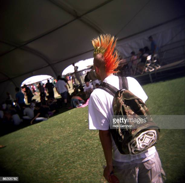 A fan walks through the festival grounds at the Coachella Valley Music and Arts Festival at the Empire Polo Fields on April 19 2009 in Indio...