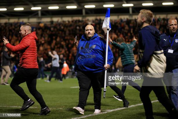 Fan walks with a corner flag following the Carabao Cup Third Round match between Colchester United and Tottenham Hotspur at JobServe Community...