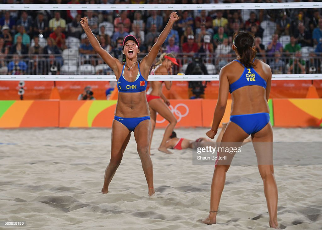 Fan Wang of China (1) and Yuan Yue of China celebrate during the Women's Beach Volleyball preliminary round Pool C match against Isabelle Forrer (1) and Anouk Verge-Depre of Switzerland on Day 1 of the Rio 2016 Olympic Games at the Beach Volleyball Arena on August 6, 2016 in Rio de Janeiro, Brazil.