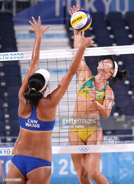 Fan Wang of Team China competes against Agatha Bednarczuk of Team Brazil during the Women's Preliminary - Pool C beach volleyball on day four of the...