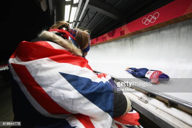 Fan watches as Lizzy Yarnold of Great Britain slides during the Women's Skeleton heat one at Olympic Sliding Centre on February 16 2018 in...