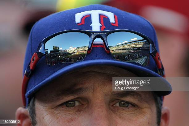 A fan watches batting practice prior to Game Five of the MLB World Series between the St Louis Cardinals and the Texas Rangers at Rangers Ballpark in...