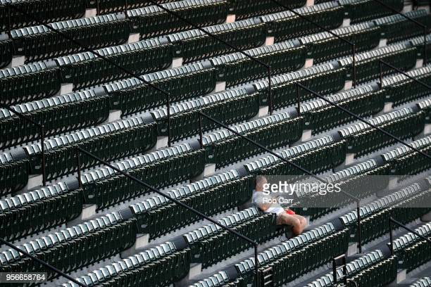 A fan watches during the third inning of the Baltimore Orioles and Kansas City Royals game at Oriole Park at Camden Yards on May 9 2018 in Baltimore...