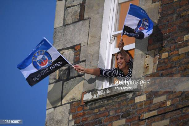 A fan watches on from a nearby window overlooking the stadium during the Gallagher Premiership Rugby match between Bath Rugby and Gloucester Rugby at...