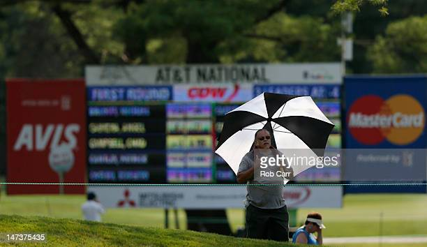 A fan watches play from the 16th hold during Round One of the ATT National at Congressional Country Club on June 28 2012 in Bethesda Maryland
