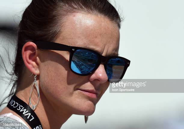 A fan watches race action as the track is reflected off her sunglasses during the Monster Energy NASCAR Cup Series Playoff Race South Point 400 on...