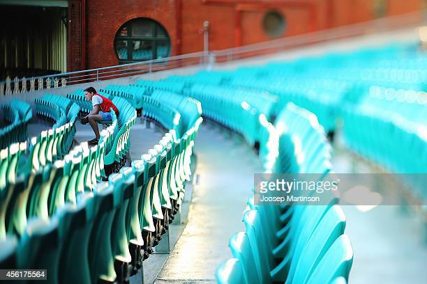 A fan watches the 2014 AFL Grand Final at the MCG from the Sydney Swans Live Site at Sydney Cricket Ground on September 27 2014 in Sydney Australia