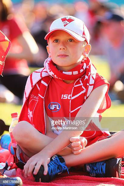 Fan watches the 2014 AFL Grand Final at the MCG from the Sydney Swans Live Site at Sydney Cricket Ground on September 27 2014 in Sydney Australia