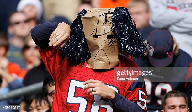 A fan watches the action during the second half of the game between the Denver Broncos and the Houston Texans at Reliant Stadium on December 22 2013...