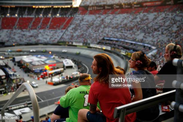 NASCAR fan watches the Bass Pro Shops NRA Night Race Qualifying Race in Bristol TN on Aug 18 2017