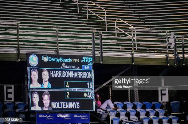 Fan watches the match between Christian and his brother Ryan Harrison against Hugo Nys of Monaco and Andrés Molteni of Argentina in the Doubles...