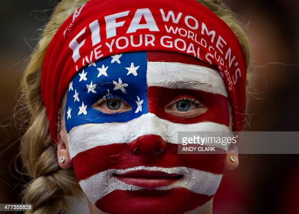 A USA fan watches the team warm up prior to a Group C football match between Nigeria and USA at BC Place Stadium in Vancouver during the FIFA Women's...
