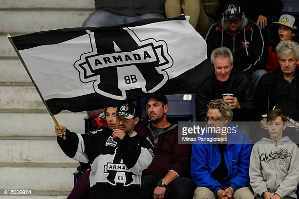 A fan waves a BlainvilleBoisbriand Armada flag during the QMJHL game against the Saint John Sea Dogs at the Centre d'Excellence Sports Rousseau on...