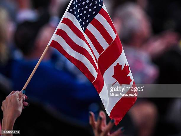 A fan waves a Canadian and United states flag during the World Cup of Hockey 2016 between Team Sweden and Team North America at Air Canada Centre on...