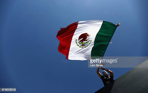 A fan waves a large Mexico flag during final practice for the Formula One Grand Prix of Mexico at Autodromo Hermanos Rodriguez on October 29 2016 in...