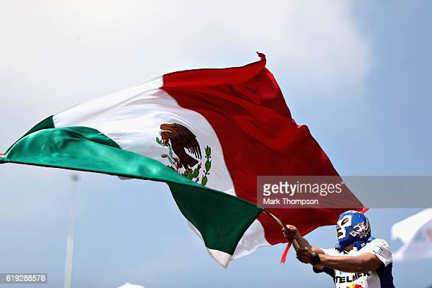 A fan waves a Mexico flag in the grandstand before the Formula One Grand Prix of Mexico at Autodromo Hermanos Rodriguez on October 30 2016 in Mexico...