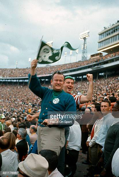 Fan waves a New York Jets pennant during Super Bowl III between the Jets and Baltimore Colts at the Orange Bowl on January 12, 1969 in Miami,...